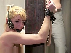 Poor slave girl tied to a pole and harshly punished