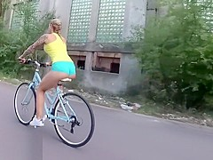 Kinky girl girl riding bicycle topless on the streets. WetKelly