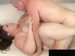 Big, beautiful Bella Bendz does an older guy on a white sofa