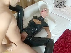 Blonde in latex takes cock deep inside her