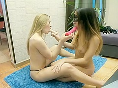 Two blonde lesbian babes play with toys naked