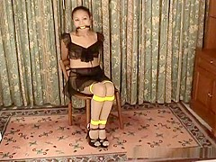 Hot Asian girl Ann is tied to a chair