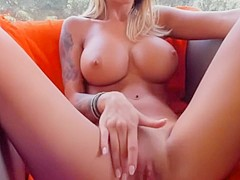 A blond romania masturbates and plays with her big tits