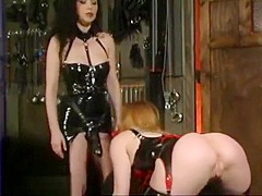 BUSTY MISTRESS IN LATEX HAS A BLONDE SLAVE PET WHO WANTS TO SUCK HER STRAP