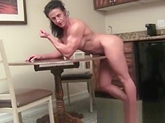 Female Bodybuilder FBB Posing and Flexing her ripped Muscles