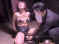An older but still sexy Japanese teacher is getting punished