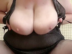 a masturbation of a hairy pussy, a mature lady. shakes big tits