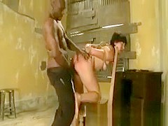 Bound slave getting whipped from her master
