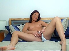 British Milf fingers her juicy pussy