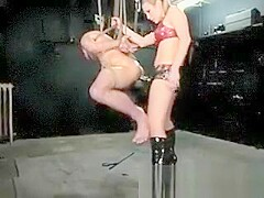 Harmony pegging suspended slave for his punishment