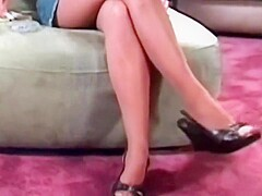 Smoking interview in glossy pantyhose, old vid with an english Goddess