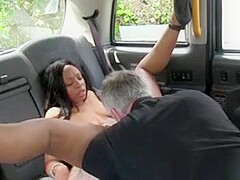 Busty ebony Brit interracial sex in a fake taxi