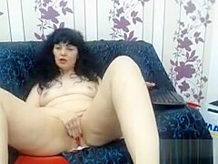 47 Years Old Esther Playing On The Couch