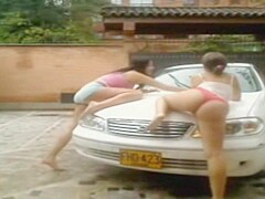 2 latin girls washing the car in the webcam