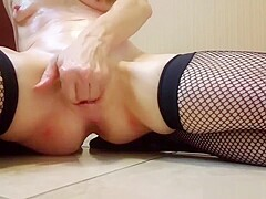 Amateur girl in fishnets posing and fingering her ass