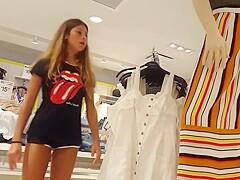 Candid voyeur teen shopping tight shorts legs model
