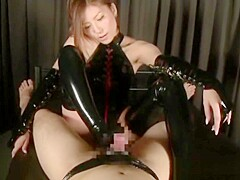 Japanese Babe Yuna Shiina gives a good footjob in plastic suit