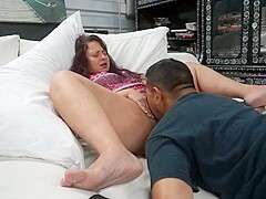 Girl gets pussy eaten on couch and has screaming orgasms