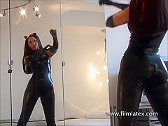 Sexy latex softcore model Justine flashes big tits