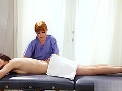 Redhead dyke masseuse toys her clients ass