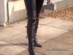 Blonde latex-babes outdoor knee boots and high heels of fetish girl in tight full body rubber outfit
