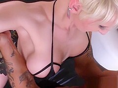 Tattooed milf dominates and pegs a sub