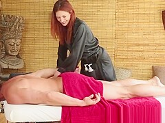 Redheaded masseuse sucks