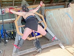 Captured helpless girl tied up and fucked by machine outdoors