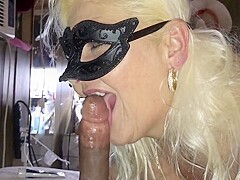 Masked milf enjoys sucking