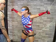 Hot babe dressed up as a superhero is getting fucked hard while being tied up