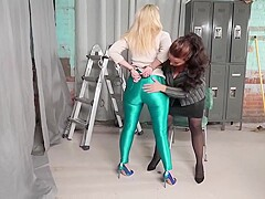 Curvaceous blonde woman in green, latex tights is getting tied up and dominated the way she likes