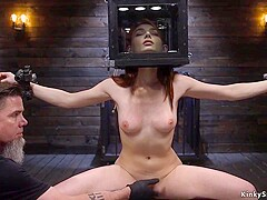 Shackled redhead slave is toyed