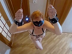 Slave girl cuffed hands up and has to cum crossed legs while standing