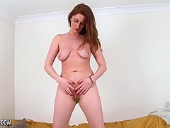Red haired chick, Princess Paris is rubbing her English pussy in front of the camera