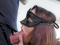 Hot brunette, Gina Ferocious is wearing a mask on her face while sucking her neighbor's cock