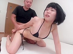 Asian brunette is showing her big, round ass and getting her soaking wet pussy stuffed with cock
