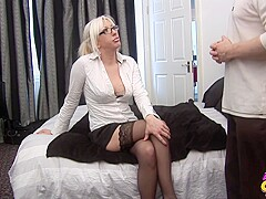 Bossy blonde is sucking her employees dick in a hotel room and expecting a good fuck