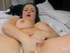 Plump mature with big, natural milk jugs is masturbating in a hotel room and enjoying it